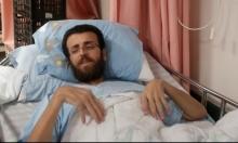 """زوجة القيق لـ""""عرب 48"""": حالته الصحية تدهورت ونقل للمشفى"""