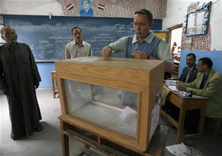 اسئلة واجوبة-ما هو النظام الذي تجرى به انتخابات البرلمان المصري؟