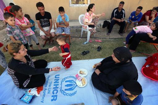 مسيحيو العراق الفارون من الجهاديين يتوقون الى الهجرة