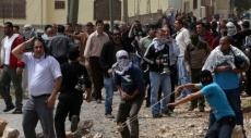 إصابات بالرصاص الحي والاختناق في قمع مسيرات الضفة الغربية