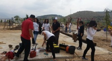 مجد الكروم: يوم عمل تطوعي دعما لحي ذيل المسيل