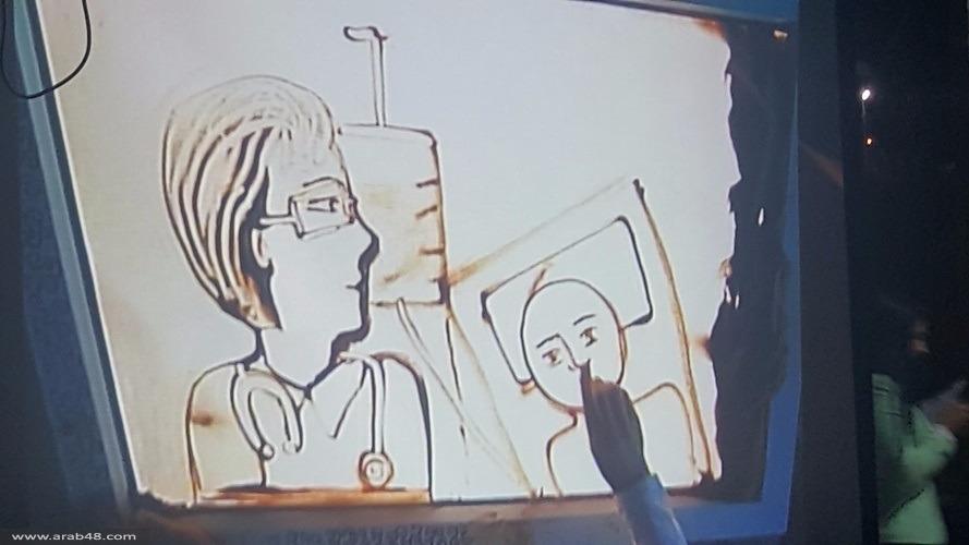 طمرة: نور دبوري فنانة ترسم بالرمل