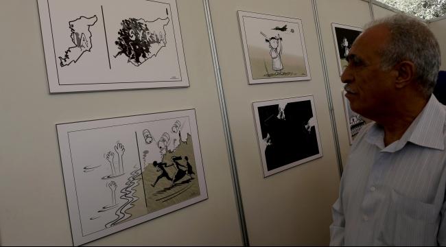 انتظار... معرض كاريكاتور في غزة