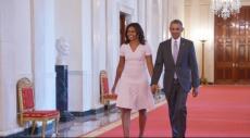 """باراك وميشيل أوباما يغنيان لآشر """"عيد ميلاد سعيد"""""""
