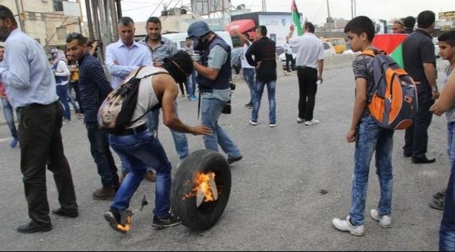 إصابة 11 فلسطينيا بالرصاص في مواجهات في قلندية