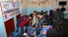 خان يونس: توزيع كسوة الشتاء على الأطفال الفقراء في خزاعة
