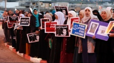 الرئيس الفلسطيني يطالب كيري بالتدخل للإفراج عن القيق