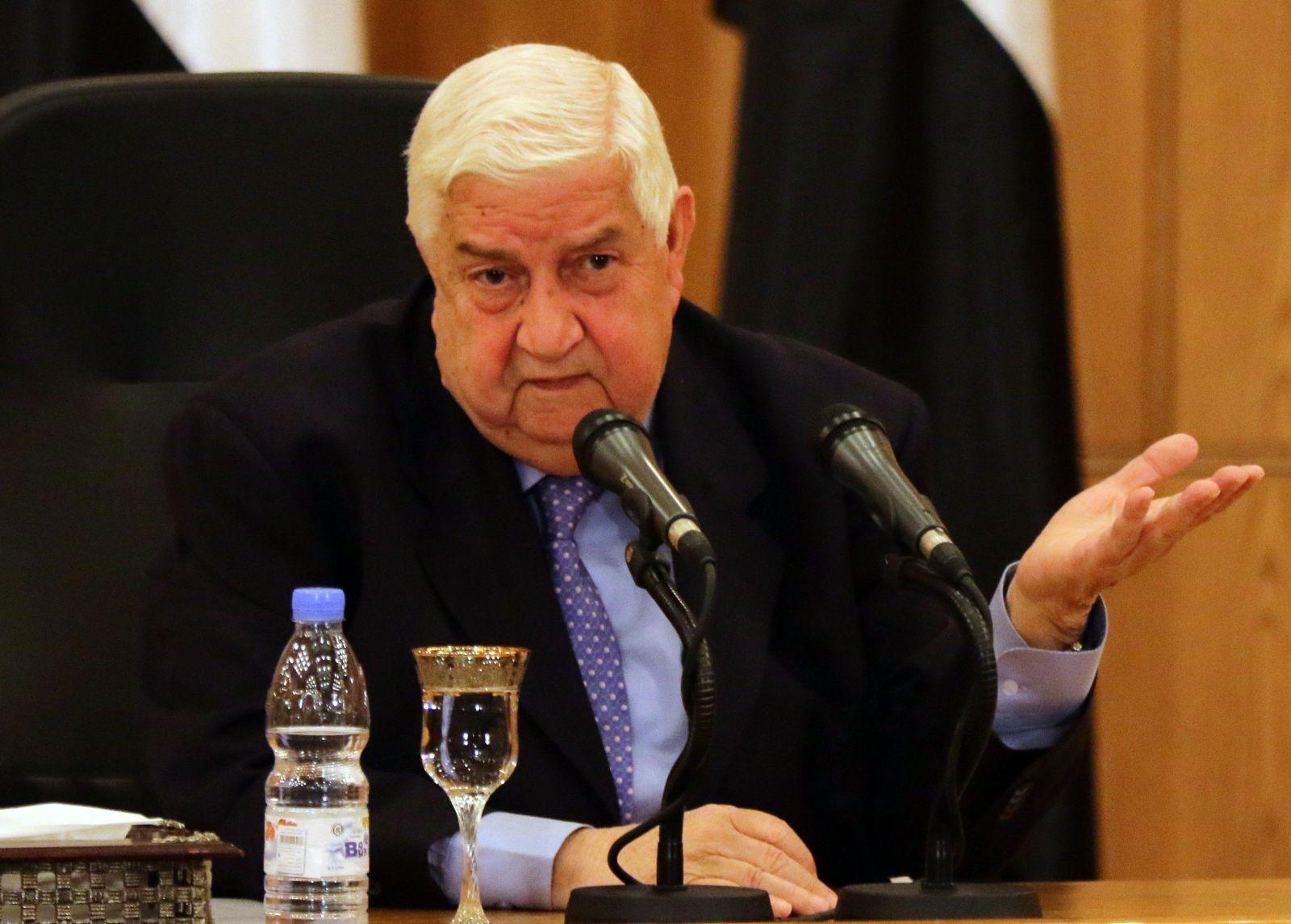 المعلم خلال مؤتمره الصحفي في دمشق اليوم (رويترز)