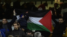 الطفل دوابشة يرفع العلم الفلسطيني بمباراة ريال مدريد