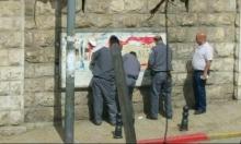 الناصرة: الجبهة تتهم البلدية بالاعتداء على ملصقات الأول من أيار