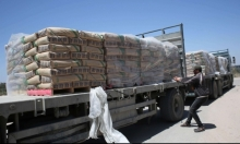 90 شاحنة إسمنت تدخل غزة
