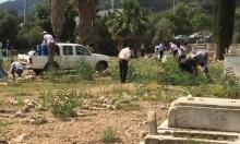 يوم عمل تطوعي بمقبرة القسام لصيانتها ومنع الاستيلاء عليها