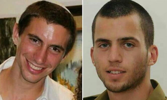 """الجيش الإسرائيلي يعرف جنديين قتلا بغزة بأنهما """"شهيدان أسيران"""""""
