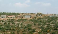 مستوطن يهدد فلسطينيين ويطلق النار في الهواء