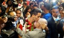 صور: الأردني أحمد أبو غوش يحظى باستقبال الأبطال