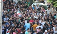نابلس: الأمن يحاول قمع عشرات الآلاف خلال تشييع حلاوة