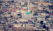 إسرائيليان يطعنان فلسطينيا في إذنا الخليل
