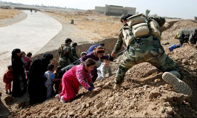 الجيش العراقي يتوغل بالموصل وسط نزوح للمدنيين