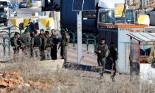 جنود الاحتلال يخفون أدلة بعد إعدام فلسطينيين