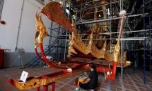 عربة مذهبة لنقل ملك تايلاند إلى الجنة