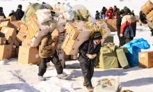 الحمالون على الحدود العراقية... لقمة ممزوجة بالثلج والدم