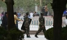 الصين: مكافأة لمن يبلغ عن شاب ملتح أو امرأة منقبة