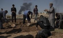 انتشال عشرات الجثث بالموصل والجيش العراقي يبرئ التحالف