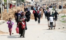 """شهود: """"داعش"""" قتل العشرات لدى محاولتهم الفرار من الموصل"""