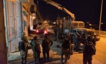 الاحتلال يعتقل 26 فلسطينيا ويصادر 5 ورش