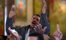 مصريون أقباط يهاجمون قوات الأمن خلال تشييع ضحايا التفجيرين