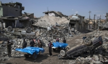 """مقتل 90 مدنيا بالموصل بنيران """"داعش"""" وقصف التحالف"""