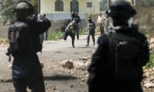 الاحتلال يعتقل 13 فلسطينيا في الضفة الغربية