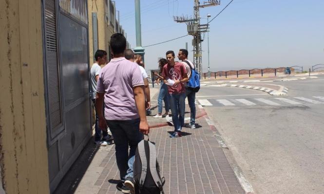 طلاب الإعدادية والثانوية يخرجون للعطلة الصيفية