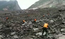 الصين: انهيار أرضي يطمر 100 شخص و يسد مجرى نهر