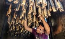 """ازدياد الإقبال على إنتاج واستهلاك أسماك """"الرنقا"""" في غزة خلال العيد"""