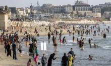 الفلسطينييون يحتفلون بعيد الفطر - شاطئ يافا (أ ف ب)