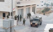 الاحتلال يحاصر دير أبو مشعل ويعتقل والد الشهيد عنكوش