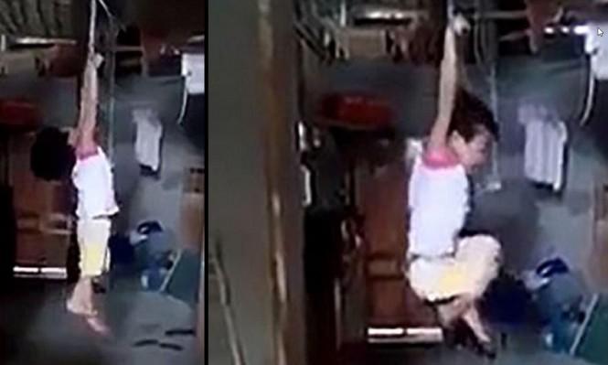 بسبب علبة حليب... امرأة فيتنامية تعلق طفلة وتعذبها