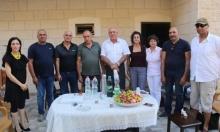 وفد جمعية الدفاع عن المهجرين يزور المحررين غنايم وغنامة