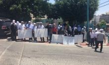 وقفة احتجاجية لموظفي مجلس طرعان رفضا للعنف