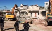 الاحتلال يهدم منزلين بسلوان ويكثف الاستيطان بالقدس