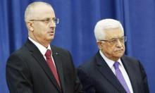 عباس يسمح لموظفي غزة بالعودة للعمل وصرف الرواتب الثلاثاء