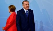 """ميركل تتوعد إردوغان """"بإعادة النظر"""" في علاقات البلدين"""