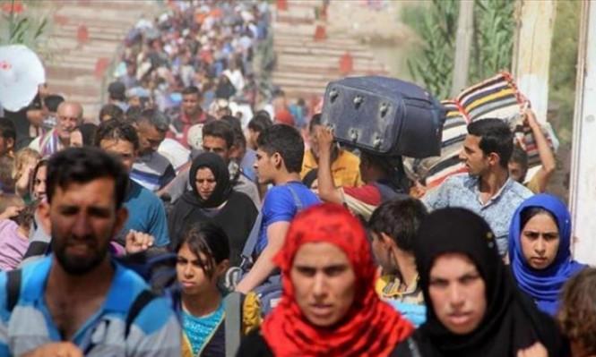 العراق: آلاف النازحين يعودون للموصل