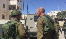 الاحتلال يحاصر بلد منفذ عملية القدس ويعتقل 15 فلسطينيا