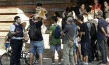 كتالونيون يحتلون مراكز اقتراع لضمان إجراء الاستفتاء