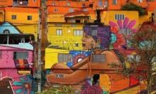 """""""نهر الحياة"""" رسم غرافيتي غطى منازل أحياء كولومبيا"""