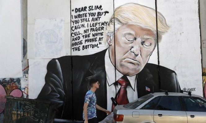 غرافيتي ترامب على جدار الفصل العنصري: ما العلاقة؟