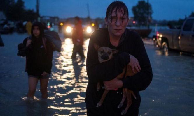 """إلزام متضرري الإعصار """"هارفي"""" بالتعهد بعدم مقاطعة إسرائيل"""