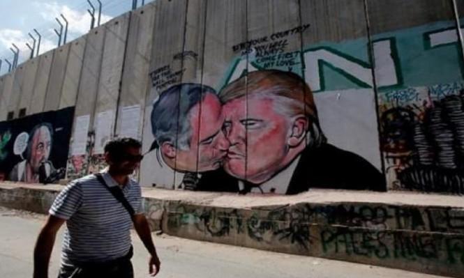 """تخريب جدارية """"القبلة الساخنة"""" بين نتنياهو وترامب ببيت لحم"""
